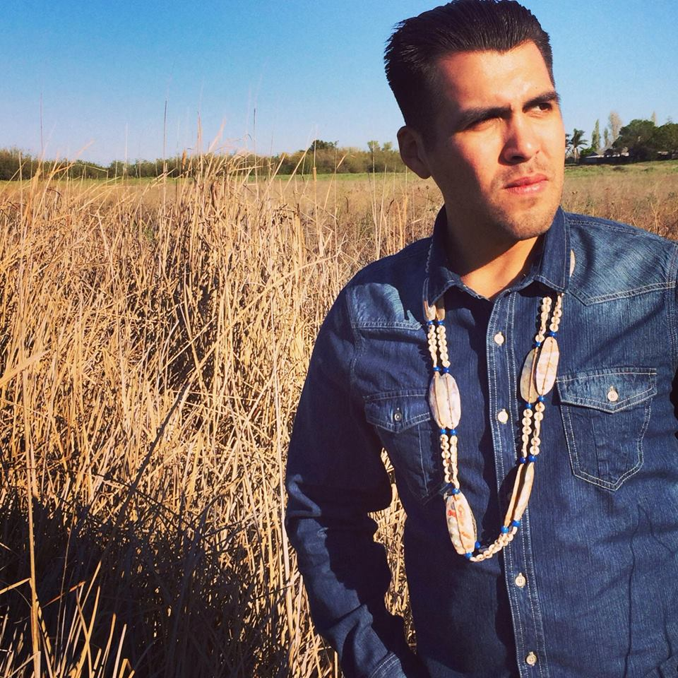 Vince Medina standing at a tule marsh in his ancestral homeland.