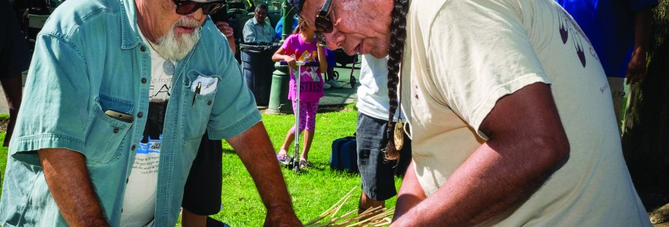 Richard Bugbee (Luiseño) and Stan Rodriguez (Kumeyaay) build a traditional tule boat. Photo courtesy of Scott Braley.