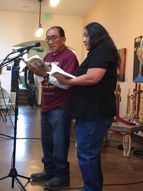 Ernest Siva and Carolyn Horsman read the words of their family member Dorothy Ramon in Serrano and English at the Dorothy Ramon Learning Center's Native Voices Poetry Festival. (taken by Terria Smith)
